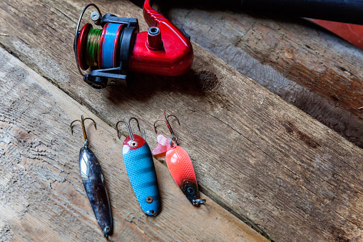istock fishing tackle on a wooden surface 842975386