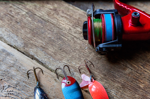 istock fishing tackle on a wooden surface 842975414