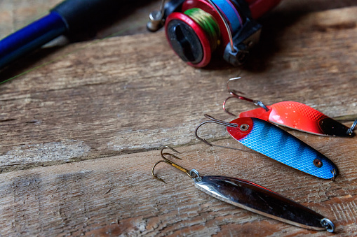 istock fishing tackle on a wooden surface 842975442