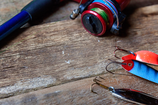 istock fishing tackle on a wooden surface 842975494