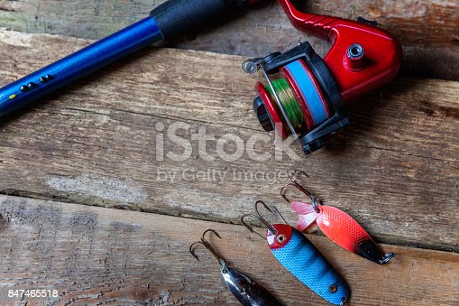 istock fishing tackle on a wooden surface 847465518