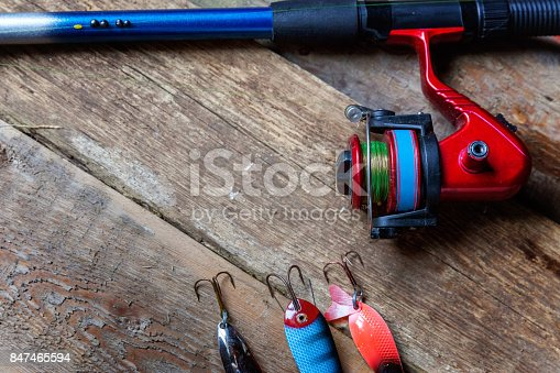 istock fishing tackle on a wooden surface 847465594