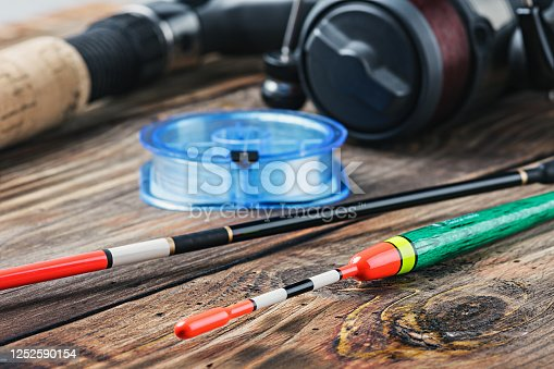 istock fishing tackle on a wooden table 1252590154