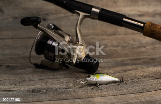 istock fishing tackle on a wooden table 920427180