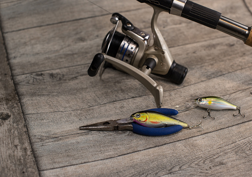 istock fishing tackle on a wooden table 920427284