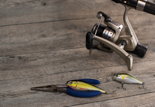 istock fishing tackle on a wooden table 920427304