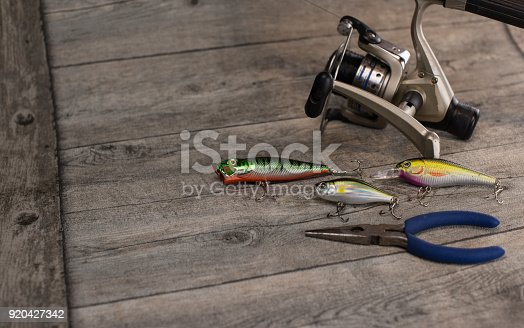 istock fishing tackle on a wooden table 920427342