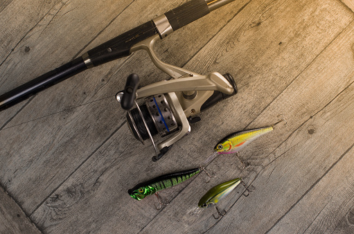 istock fishing tackle on a wooden table 920427428
