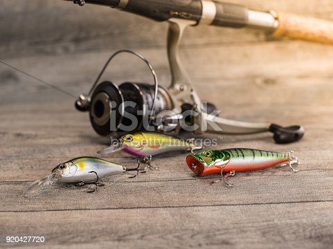 istock fishing tackle on a wooden table 920427720