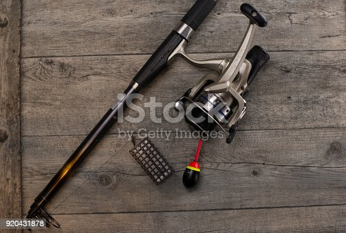 istock fishing tackle on a wooden table 920431878