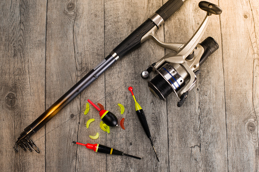 istock fishing tackle on a wooden table 920434062