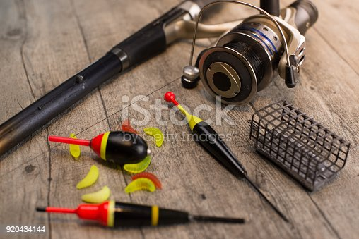 istock fishing tackle on a wooden table 920434144