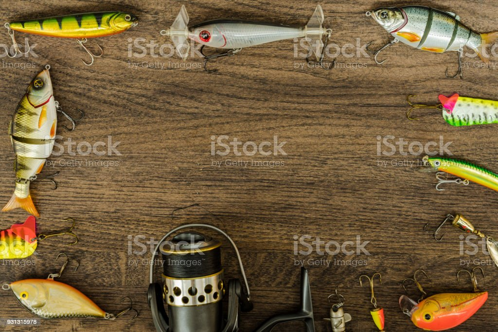 Fishing tackle on darken wooden background. Top view. stock photo