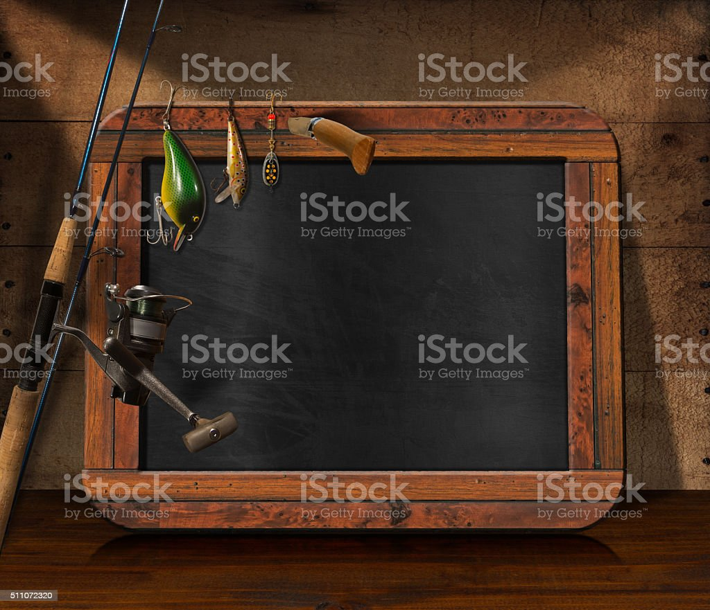 Fishing Tackle with Empty Blackboard stock photo