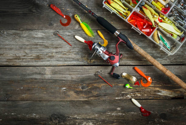fishing tackles - fishing spinning and box with color fishing tackles on wooden boards. top view. copy space - traditional ceremony stock pictures, royalty-free photos & images