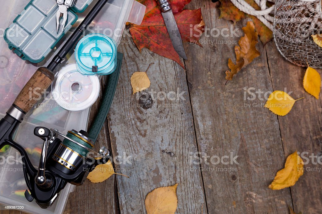 fishing tackles on board with leafs of autumn stock photo