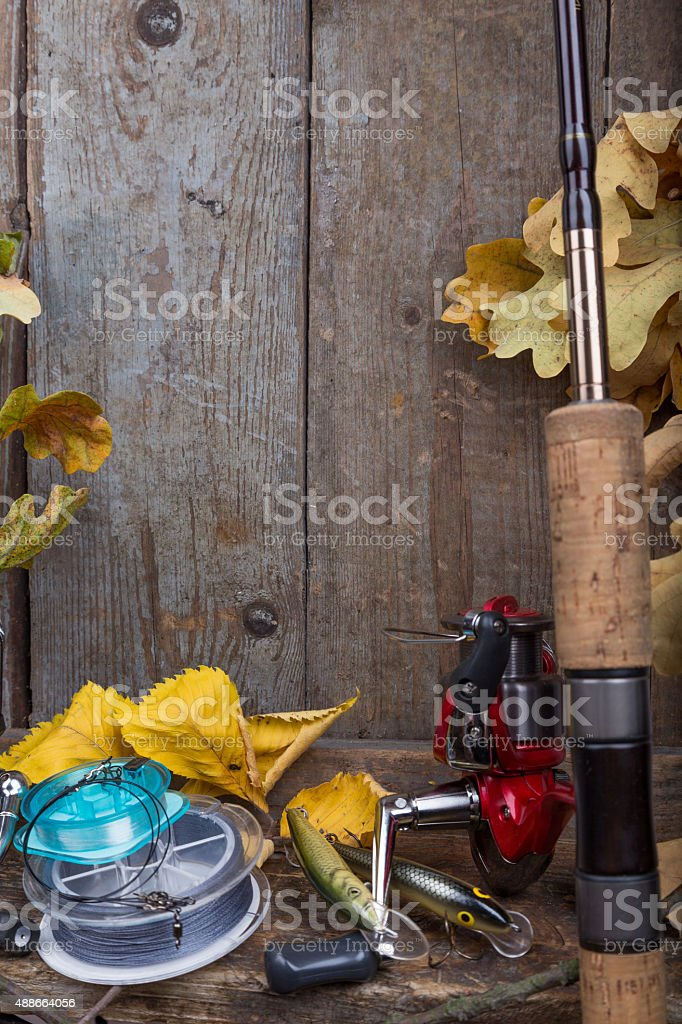 fishing tackles on old wooden board stock photo