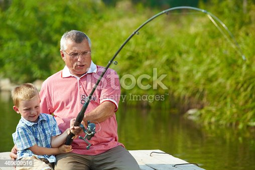 992209122 istock photo Fishing together 469609516