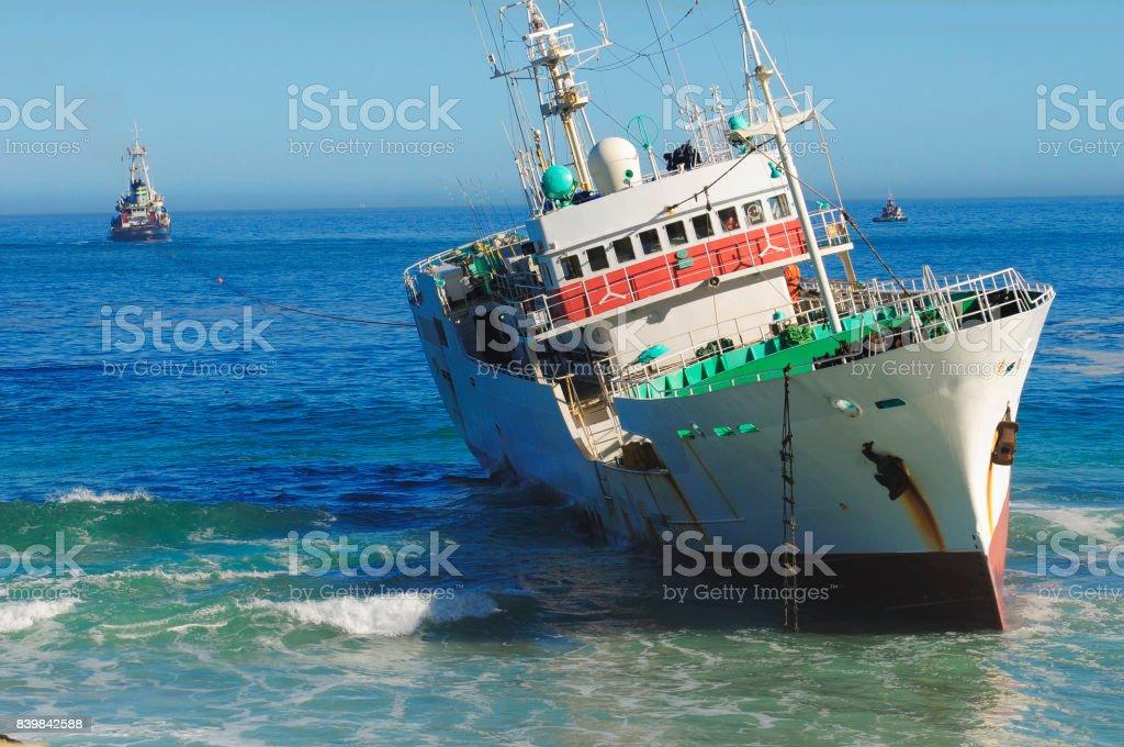Fishing trawler beached stock photo