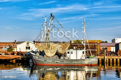 Buesum, Germany – August 1, 2018: Fishing trawler in the port of Buesum in North Frisia (Germany)