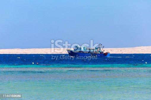 Fishing trawler sails at Red sea in Hurghada, Egypt