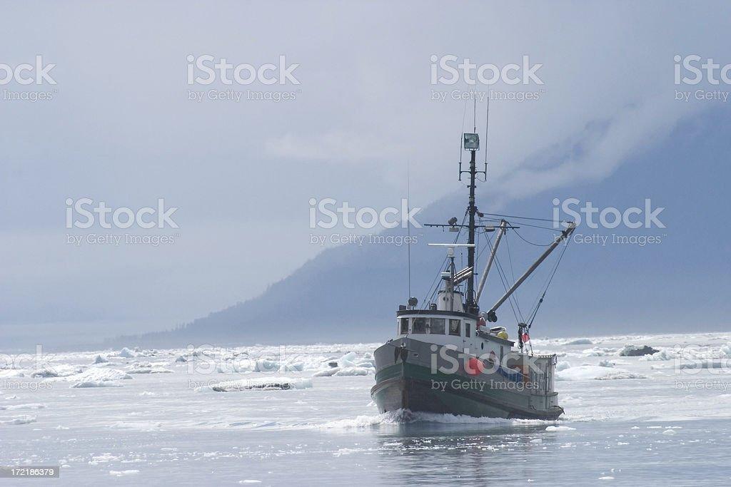 Fishing Trawlerr in Northern Ice Filled Water stock photo