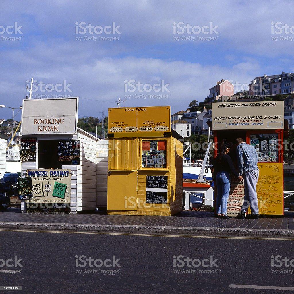 Fishing trip kiosks at Brixham, Devon, England royalty-free stock photo