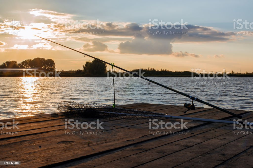fishing utensils on a wooden platform stock photo