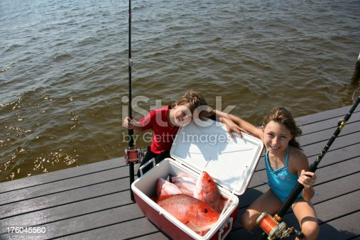 Beautiful afternoon two cute kids showing off their  Red Snapper catch ... So Proud!  Copy Space!
