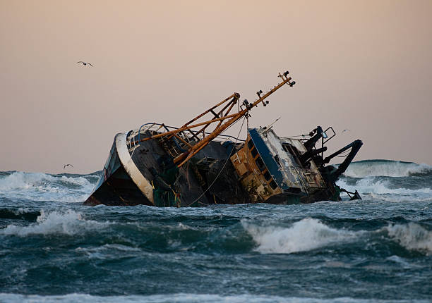 fishing vessel boat aground on sea - shipwreck stock pictures, royalty-free photos & images