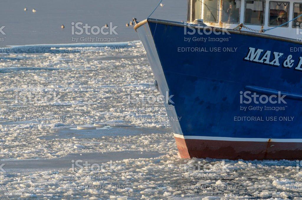 Fishing vessel Max & Emma in icy harbor stock photo