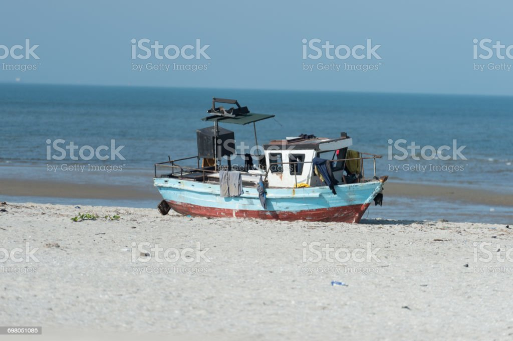 Fishing vessel moored on beach in Maputo bay, Mozambique stock photo