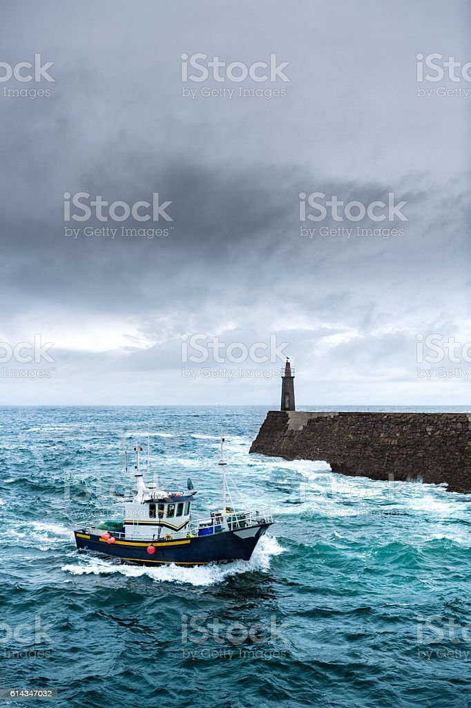 Fishing Vessel under Storm stock photo