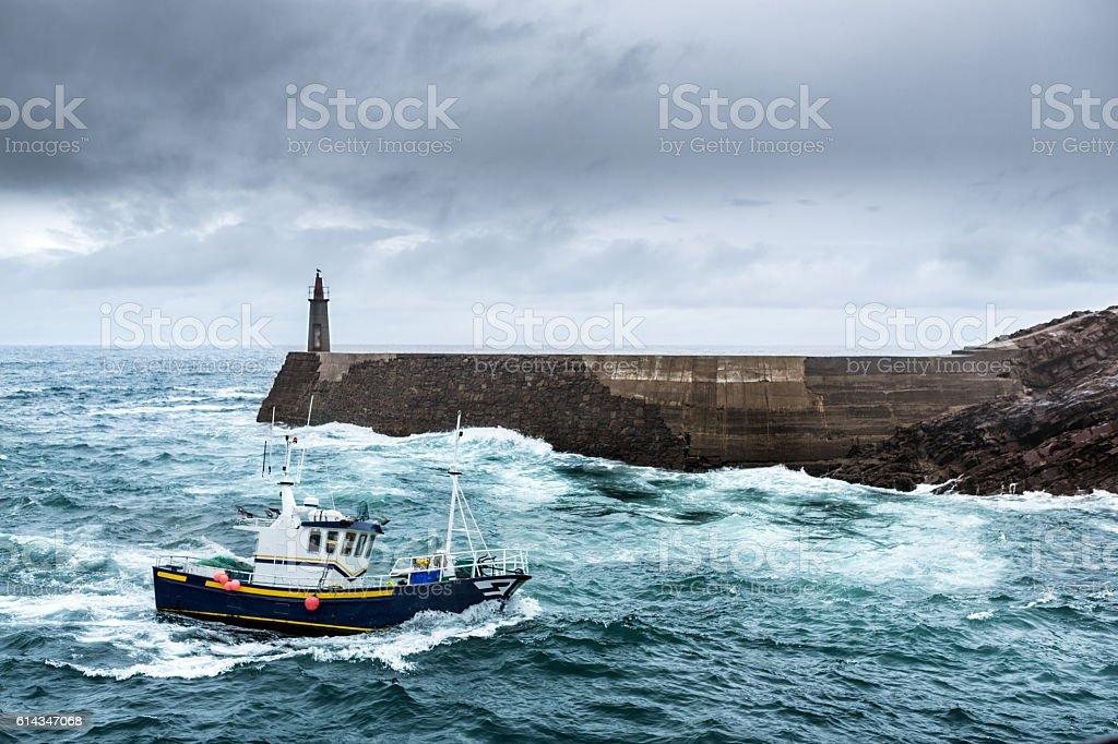 Fishing Vessel under Storm stock photo