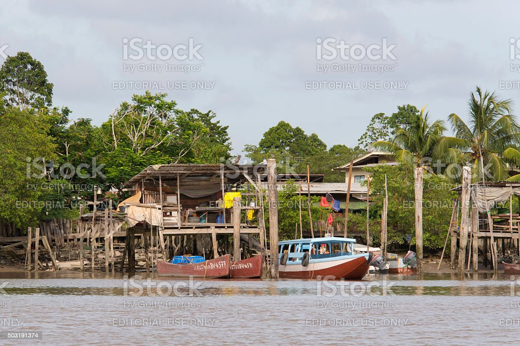 Fishing village and boats on the Suriname River stock photo