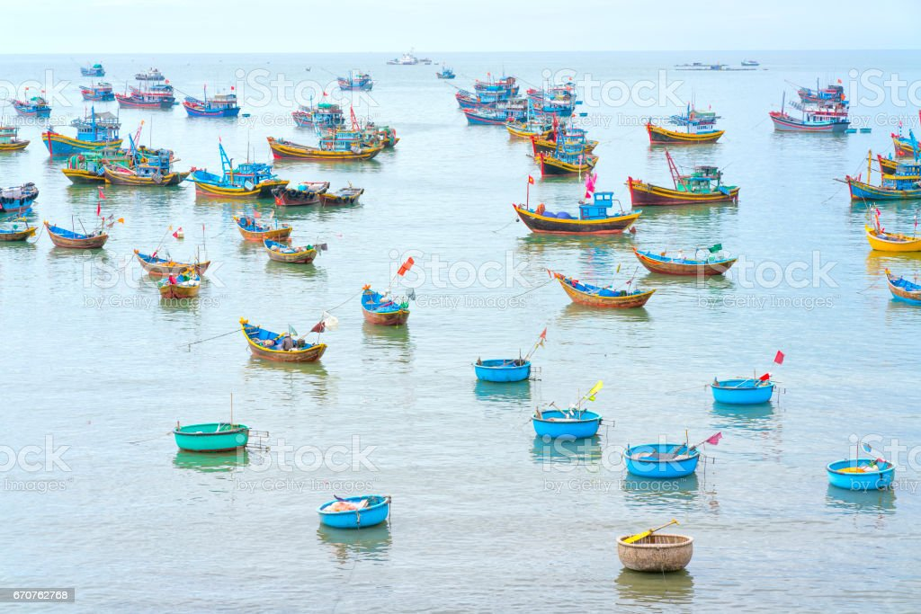 Fishing village and traditional Vietnamese fishing boats stock photo