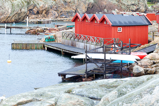 Swedish fishing village, red cottages in a row. Bohuslan, Gothenburg, Sweden. This submission contains an image with the Clients Needs Code; CNEUTRV564