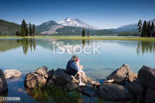 483319252 istock photo Fishing, with grandpa helping granddaughter hold rod 171324259