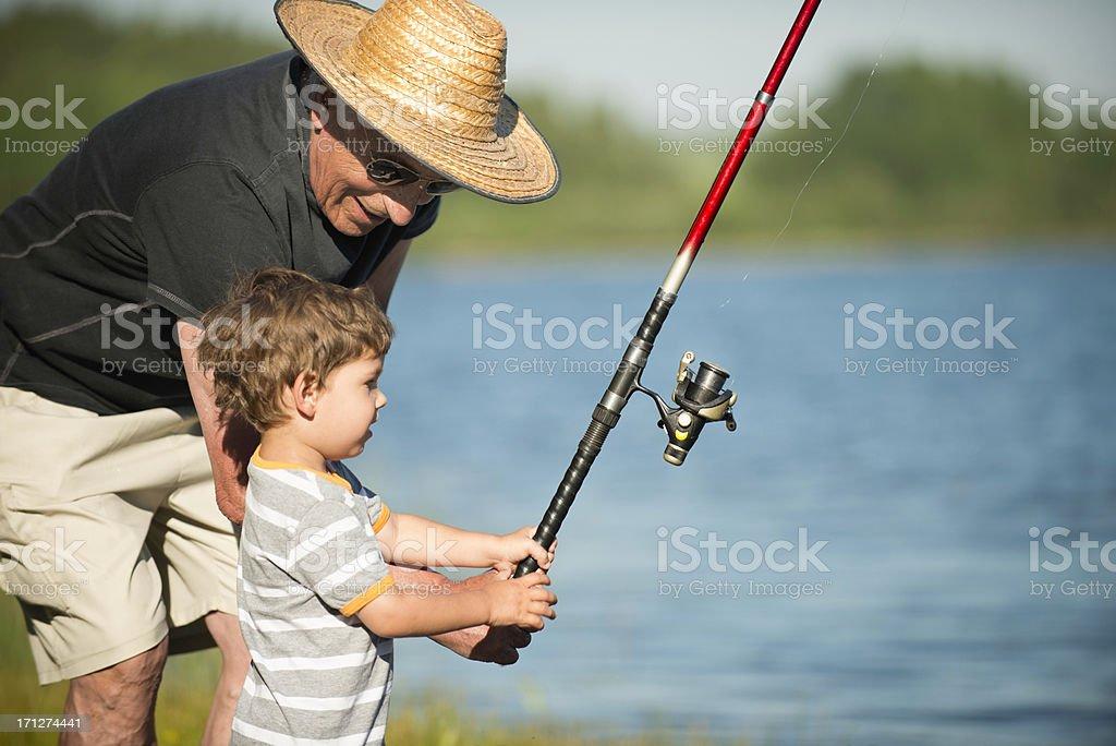 Fishing with grandpa royalty-free stock photo