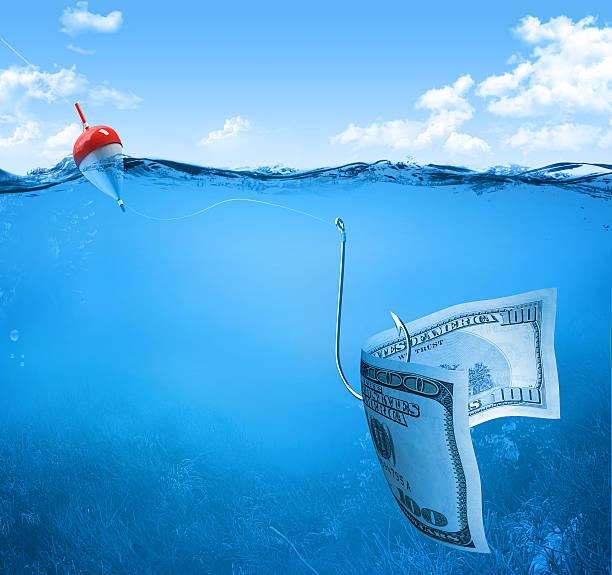 fishing with money stock photo