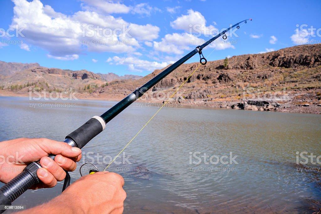 Fishing with rod on lake stock photo