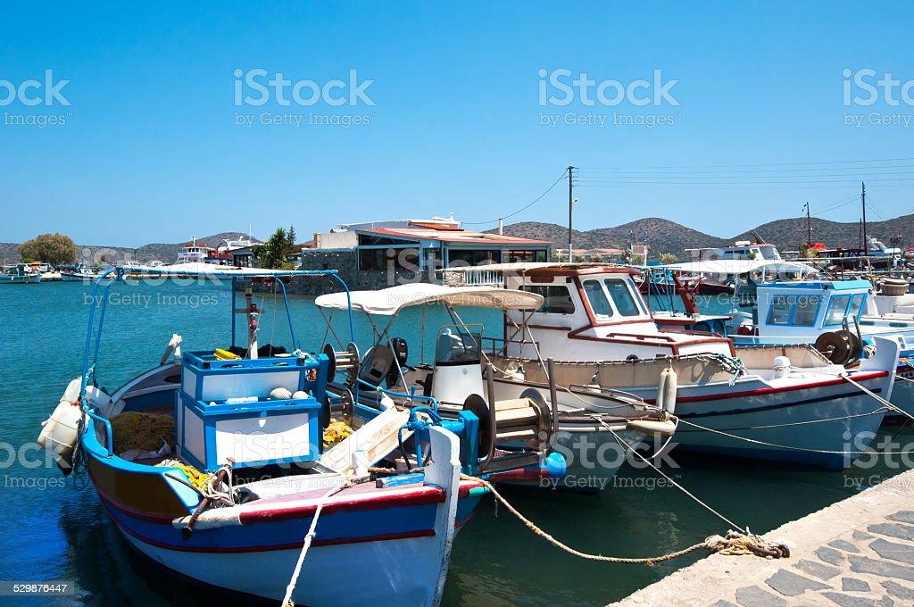 Fishing yacht at the port of Creta stock photo