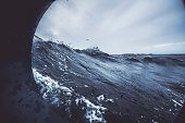 Fishingboat vessel fishing in a rough sea