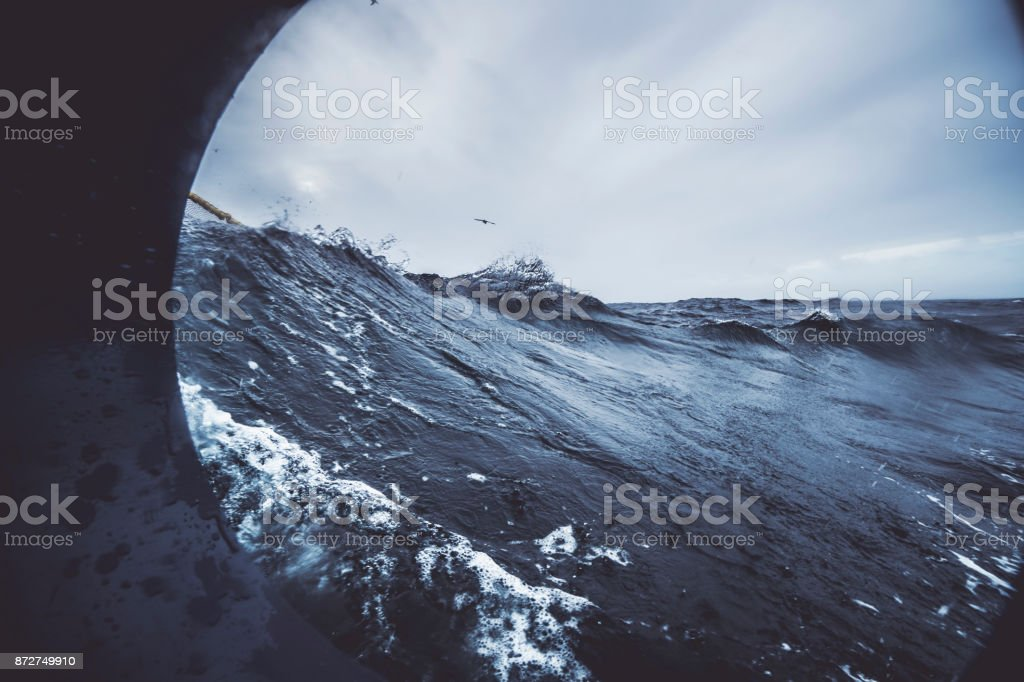 Fishingboat vessel fishing in a rough sea stock photo