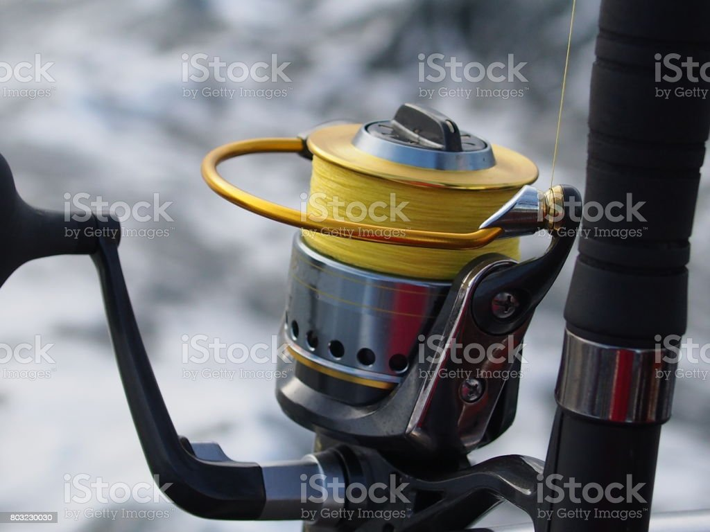 fishing-rod with spinning-wheel stock photo