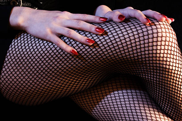 Fishnet Legs and Ruby Red Nails stock photo