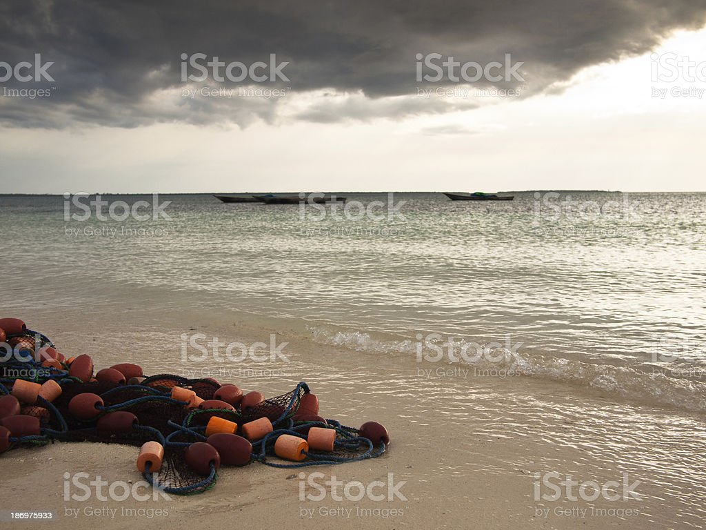 Fishnet lies on the shore royalty-free stock photo