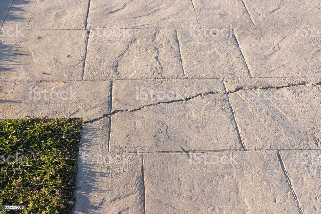 Fissured stamped concrete pavement outdoor, appearance colors and textures of stock photo