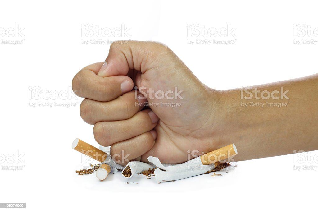 fist breaking cigarette stop smoking concept on white background stock photo