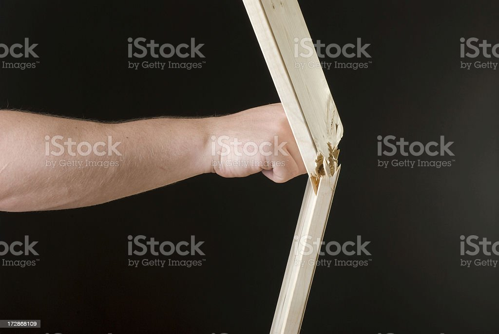 Fist breaking the plank royalty-free stock photo